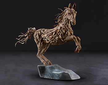 A horse rears up Long dead driftwood on a stainless steel armature mounted on a solid marble base 1/4th actual size
