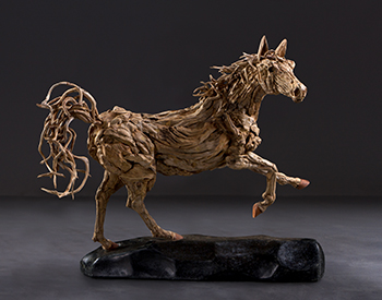 A Thoroughbred stops on a sixpence Long dead driftwood on a stainless steel armature mounted on a solid marble base.1/4th actual size