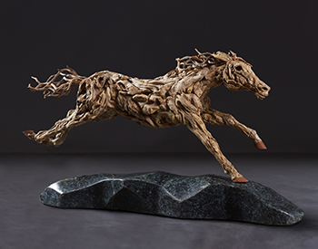 A Thoroughbred racing towards the home stretch Long dead driftwood on a stainless steel armature mounted on a solid marble base 1/4th actual size