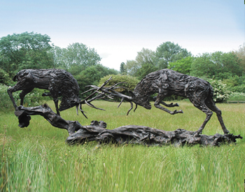 A Bronze of two rutting stags cast from silica bronze limited edition of 6