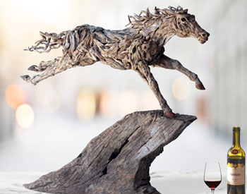Fire Tail is inspired by a painting of George Stubbs by the same name Long dead driftwood is bolted screwed and welded onto a stainless steel armature that descends through a gnarly plinth Suitable for both indoors and out